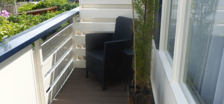 Balkon naast slaapkamer opgefleurd